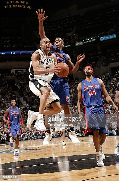 ec32fe444 Tony Parker of the San Antonio Spurs drives for a shot attempt past  Chauncey Billups and