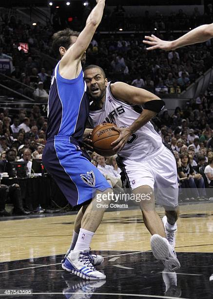 Tony Parker of the San Antonio Spurs drives into the lane against Jose Calderon of the Dallas Mavericks in Game Five of the Western Conference...