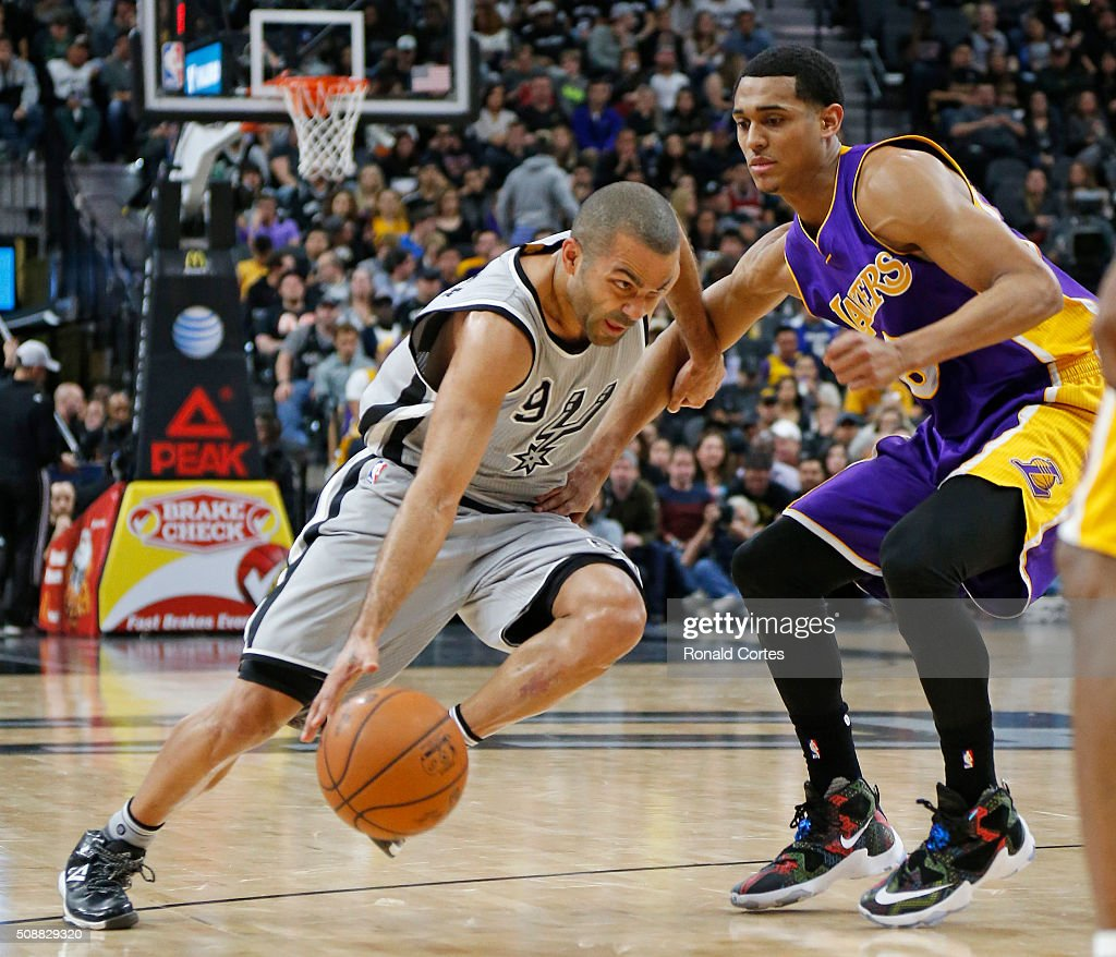 Tony Parker #9 of the San Antonio Spurs drives on Jordan Clarkson #6 of the Los Angeles Lakers at AT&T Center on February 6, 2016 in San Antonio, Texas.