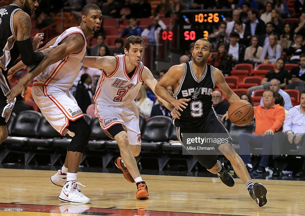 Tony Parker #9 of the San Antonio Spurs drives past Goran Dragic #7 and Chris Bosh #1 of the Miami Heat during a game at American Airlines Arena on February 9, 2016 in Miami, Florida.