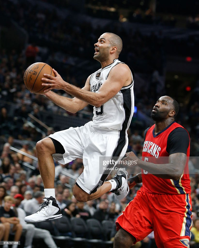 Tony Parker #9 of the San Antonio Spurs drives past Kendrick Perkins #5 of the New Orleans Pelicans at AT&T Center on March 30, 2016 in San Antonio, Texas.
