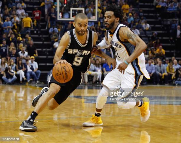Tony Parker of the San Antonio Spurs drives past Mike Conley of the Memphis Grizzlies during the second half of a 10396 Spurs victory in Game 6 of...