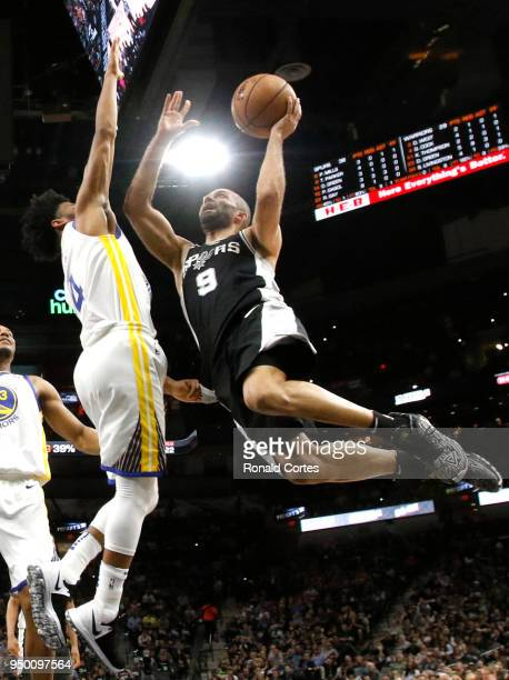 Tony Parker of the San Antonio Spurs drives past Quinn Cook of the Golden State Warriors in the first half of Game Four of Round One of the 2018 NBA...