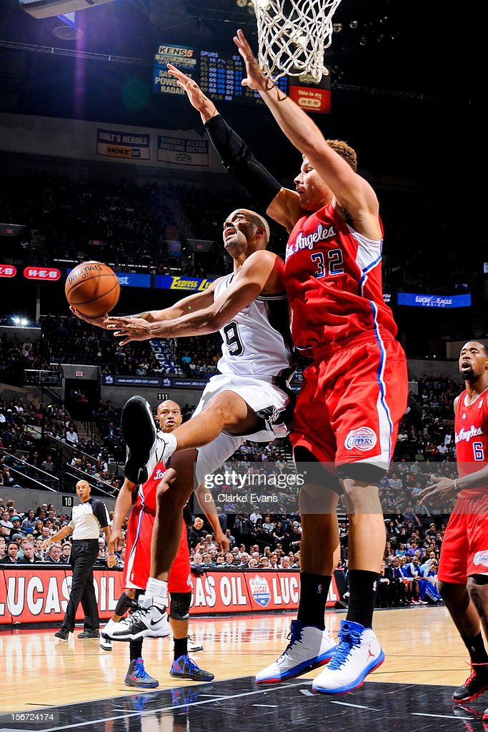 Tony Parker #9 of the San Antonio Spurs drives to the basket against Blake Griffin #32 of the Los Angeles Clippers on November 19, 2012 at the AT&T Center in San Antonio, Texas.
