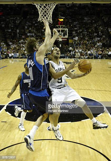 Tony Parker of the San Antonio Spurs drives to the basket against Dirk Nowitzki of the Dallas Mavericks in Game two of the Western Conference...