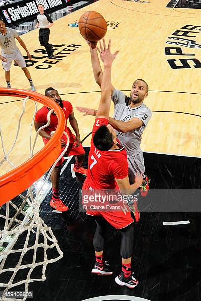 Tony Parker of the San Antonio Spurs drives to the basket against the Houston Rockets during the game at the ATT Center on December 25 2013 in San...