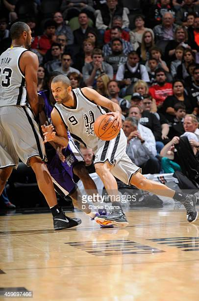 Tony Parker of the San Antonio Spurs drives to the basket against the Sacramento Kings on November 28 2014 at the ATT Center in San Antonio Texas...