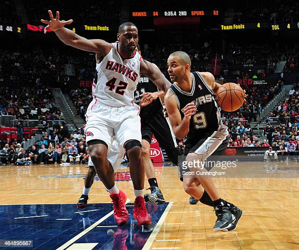 Tony Parker of the San Antonio Spurs drives to the basket against the Atlanta Hawks on January 24 2014 at Philips Arena in Atlanta Georgia NOTE TO...
