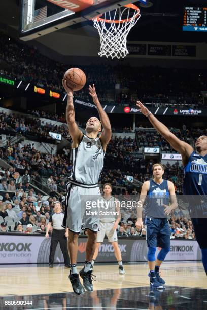 Tony Parker of the San Antonio Spurs drives to the basket against the Dallas Mavericks on November 27 2017 at the ATT Center in San Antonio Texas...