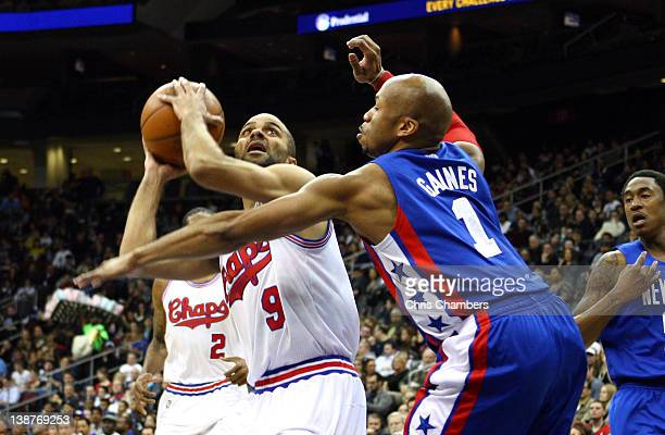 Tony Parker of the San Antonio Spurs drives to the basket in the first half in against Sundiata Gaines of the New Jersey Nets at Prudential Center on...