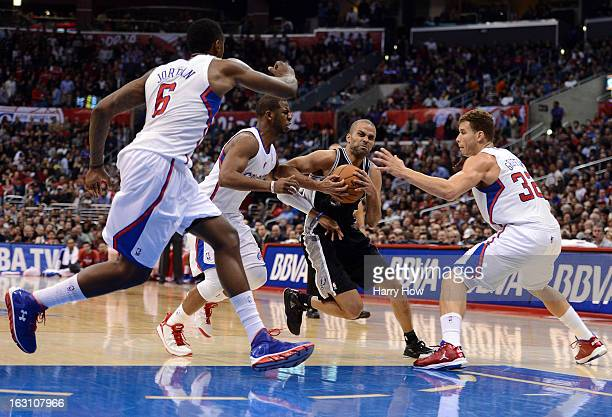Tony Parker of the San Antonio Spurs drives to the basket past Chris Paul DeAndre Jordan and Blake Griffin of the Los Angeles Clippers at Staples...