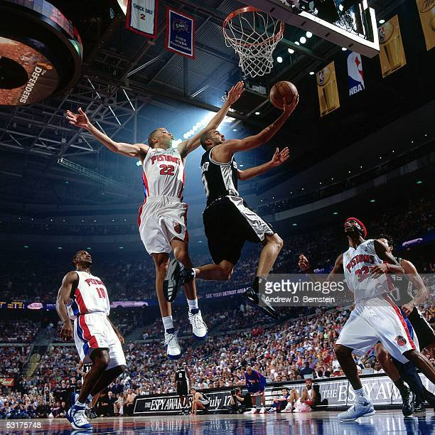 Tony Parker of the San Antonio Spurs goes for a layup against Tayshaun Prince of the Detroit Pistons in Game Five of the 2005 NBA Finals at the...