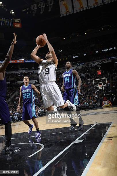 Tony Parker of the San Antonio Spurs goes to the basket against the Charlotte Hornets on January 28 2015 at the ATT Center in San Antonio Texas NOTE...