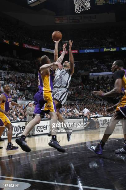 Tony Parker of the San Antonio Spurs goes to the basket under pressure during the Game One of the Western Conference Quarterfinals between the Los...