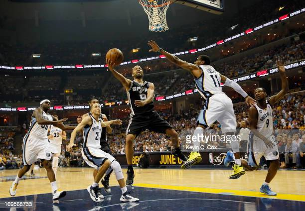 Tony Parker of the San Antonio Spurs goes up for a shot against Mike Conley of the Memphis Grizzlies in the first quarter during Game Four of the...