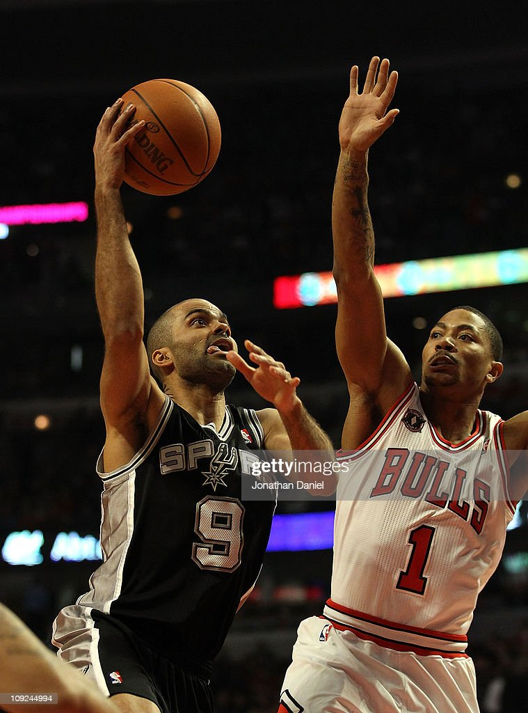 Tony Parker #9 of the San Antonio Spurs goes up for a shot against Derrick Rose #1 of the Chicago Bulls at the United Center on February 17, 2011 in Chicago, Illinois.