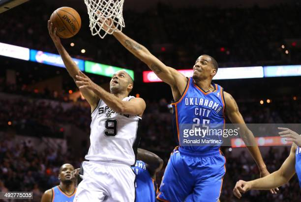 Tony Parker of the San Antonio Spurs goes up for a shot against Thabo Sefolosha of the Oklahoma City Thunder in the first quarter in Game Two of the...