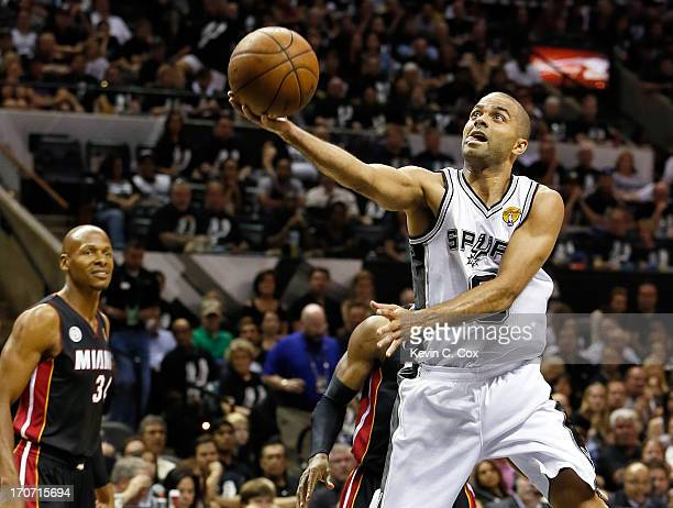 Tony Parker of the San Antonio Spurs goes up for a shot as Ray Allen of the Miami Heat looks on in the first half during Game Five of the 2013 NBA...
