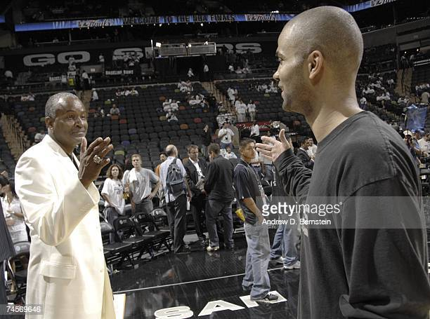 Tony Parker of the San Antonio Spurs greets his dad Tony Parker Sr prior to Game One of the 2007 NBA Finals at The ATT Center on June 7 2007 in San...