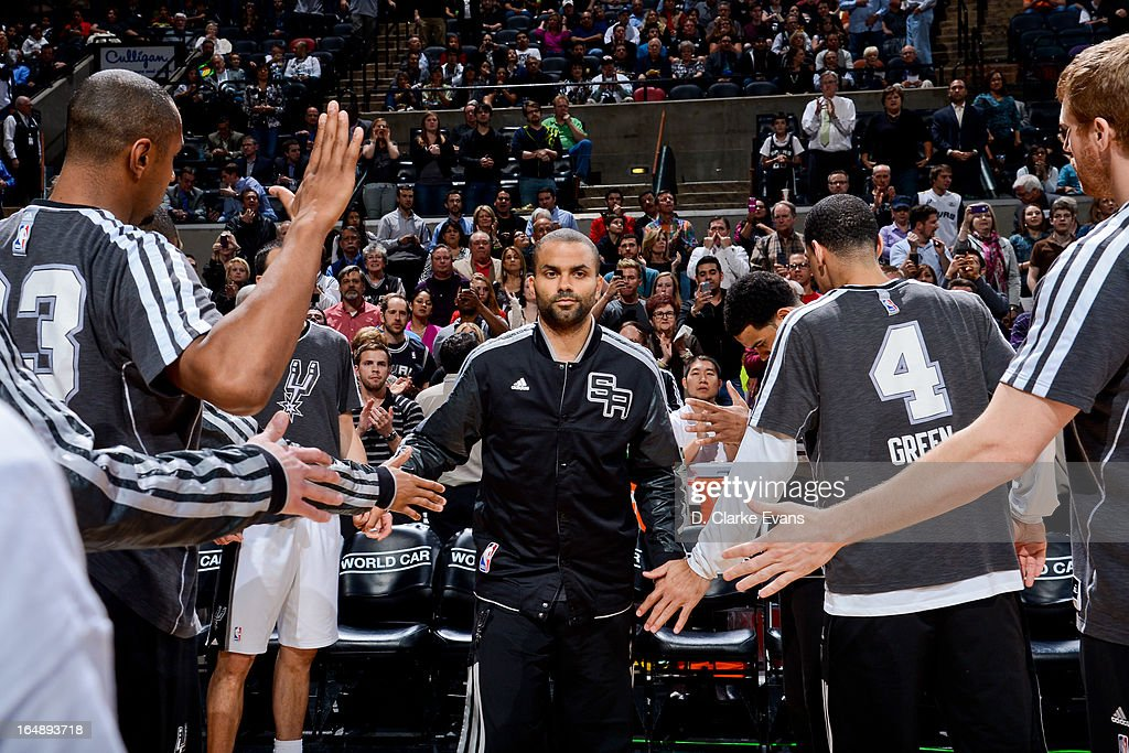 Tony Parker #9 of the San Antonio Spurs greets teammates before playing against the Denver Nuggets on March 27, 2013 at the AT&T Center in San Antonio, Texas.