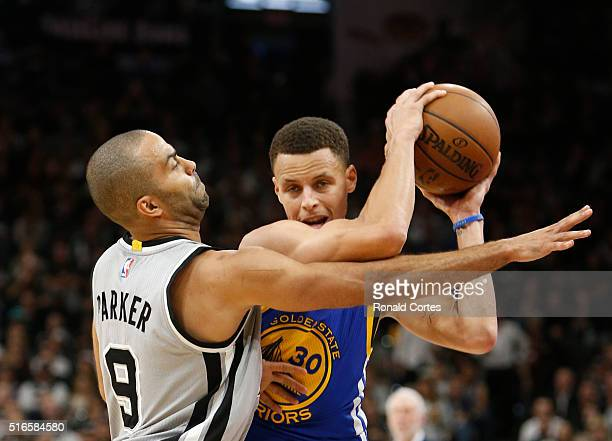 Tony Parker of the San Antonio Spurs guards Stephen Curry of the Golden States Warriors at ATT Center on March 19 2016 in San Antonio Texas NOTE TO...