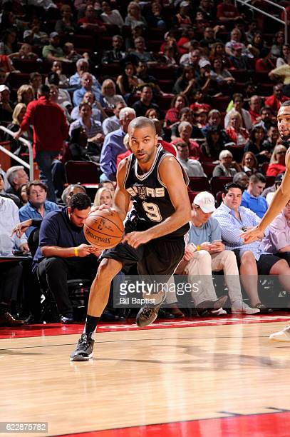 Tony Parker of the San Antonio Spurs handles the ball during a game against the Houston Rockets on November 12 2016 at the Toyota Center in Houston...