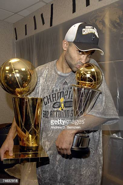 Tony Parker of the San Antonio Spurs holds the MVP and Larry O'Brien trophy after Game Four of the 2007 NBA Finals at The Quicken Loans Arena on June...