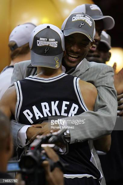 Tony Parker of the San Antonio Spurs hugs his father Tony Parker Sr after the win against the Cleveland Cavaliers in Game Four of the NBA Finals on...