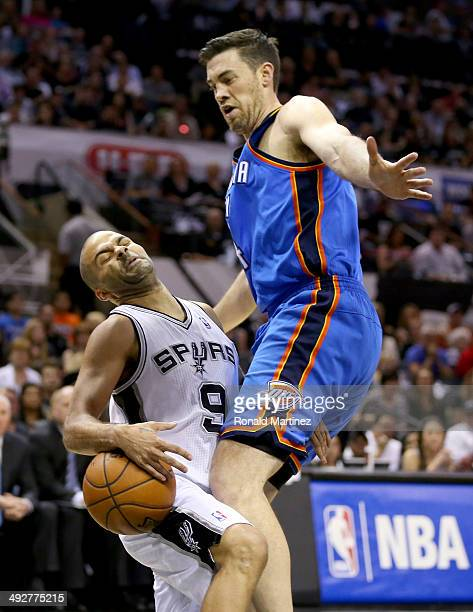 Tony Parker of the San Antonio Spurs is fouled by Nick Collison of the Oklahoma City Thunder in the first quarter in Game Two of the Western...