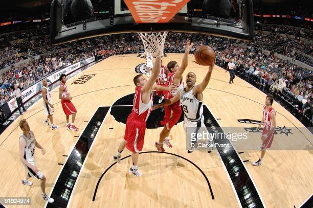 Tony Parker of the San Antonio Spurs lays up a shot against Linas Kleiza of the Greece Olympiacos during the exhibition game on October 9 2009 at the...
