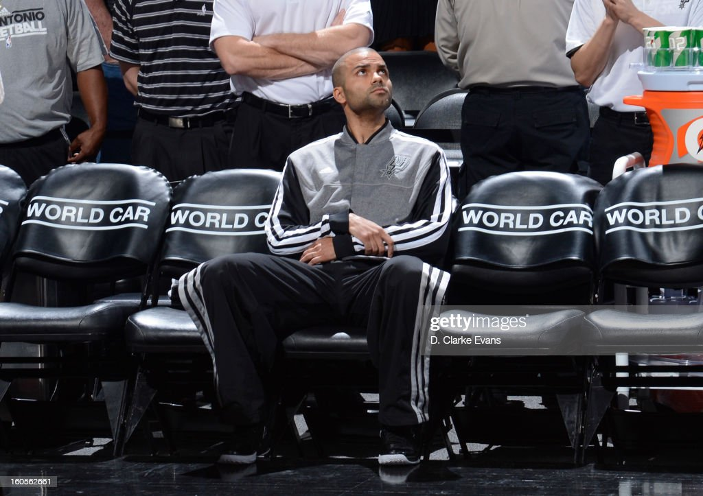 Tony Parker #9 of the San Antonio Spurs looks on before the game between the Washington Wizards and the San Antonio Spurs on February 2, 2013 at the AT&T Center in San Antonio, Texas.