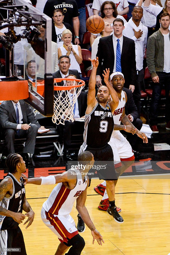 Tony Parker #9 of the San Antonio Spurs makes a shot with seconds left in the fourth quarter to put his team ahead by four points against LeBron James #6 of the Miami Heat during Game One of the 2013 NBA Finals on June 6, 2013 at American Airlines Arena in Miami, Florida.