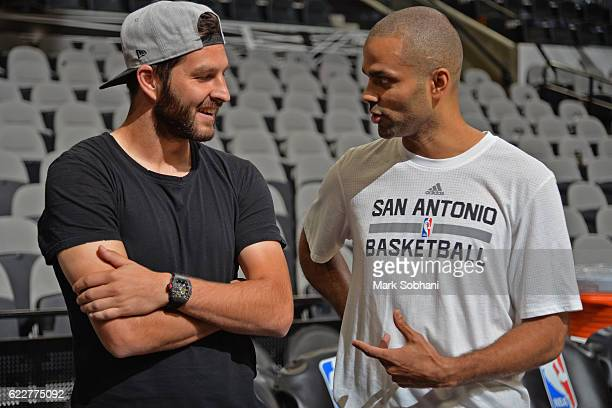 Tony Parker of the San Antonio Spurs meets with French professional footballer AndréPierre Gignac before the game against the Detroit Pistons on...