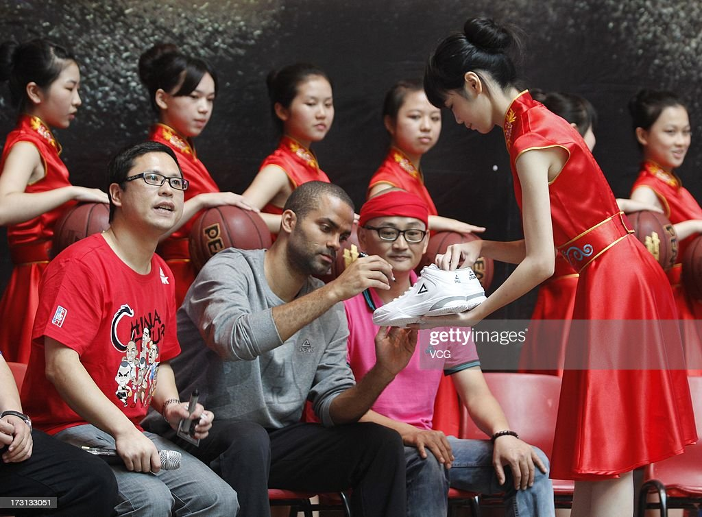 Tony Parker of the San Antonio Spurs meets with with fans at Quanzhou No.7 Middle School on July 8, 2013 in Quanzhou, China.