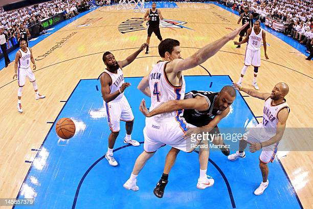 Tony Parker of the San Antonio Spurs passes the ball against James Harden Nick Collison and Derek Fisher of the Oklahoma City Thunder in Game Six of...