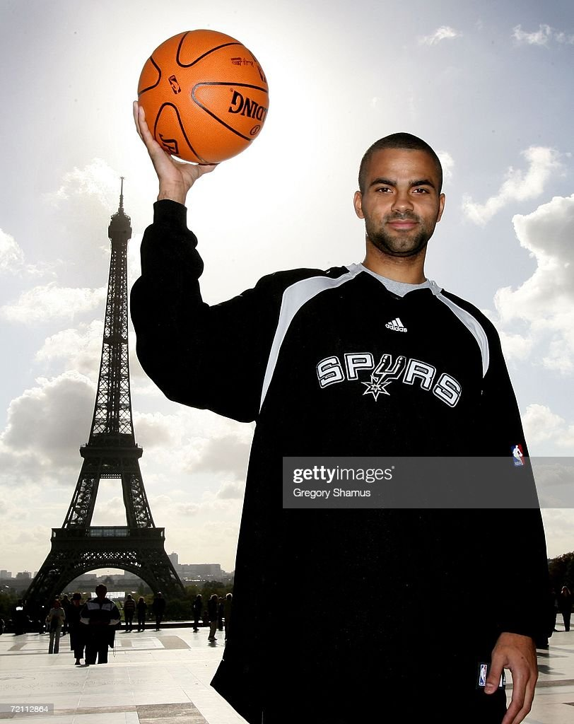 Tony Parker #9 of the San Antonio Spurs poses in front of the Eiffel Tower during the NBA Europe Live Tour presented by EA Sports on October 7, 2006 in Paris, France.