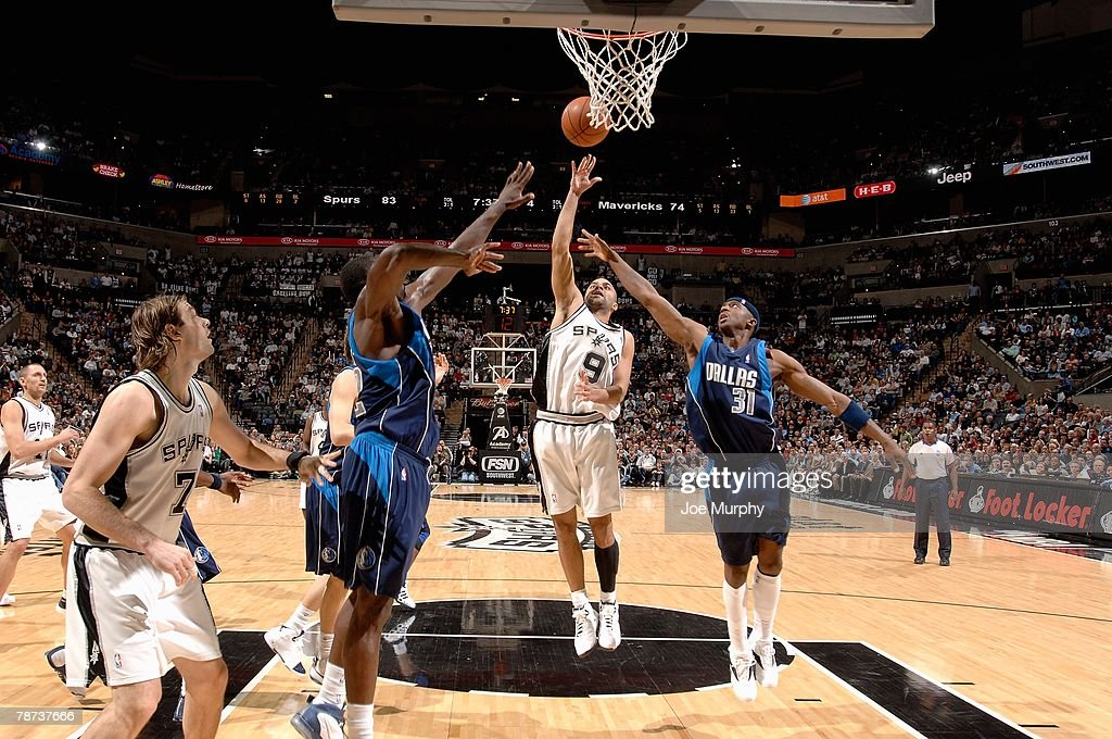 Tony Parker #9 of the San Antonio Spurs puts a shot up over Jason Terry #31 of the Dallas Mavericks during the game on December 5, 2007 at the AT&T Center in San Antonio, Texas. The Spurs won 97-95.