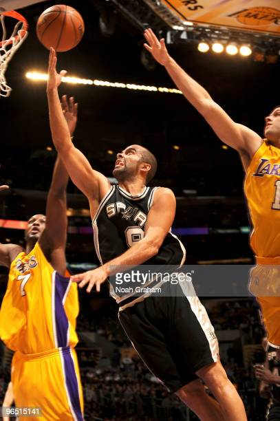 Tony Parker of the San Antonio Spurs puts up a shot against Lamar Odom and Jordan Farmar of the Los Angeles Lakers at Staples Center on February 8...