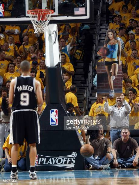 Tony Parker of the San Antonio Spurs shoots a free throw as a New Orleans Hornets fan holds up a poster of Eva Longoria in Game Five of the Western...