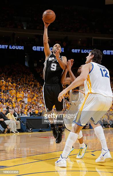 Tony Parker of the San Antonio Spurs shoots a layup against Jarrett Jack and Andrew Bogut of the Golden State Warriors in Game Four of the Western...