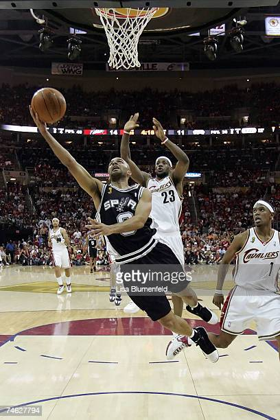 Tony Parker of the San Antonio Spurs shoots a layup against LeBron James of the Cleveland Cavaliers as Daniel Gibson looks on in Game Four of the NBA...
