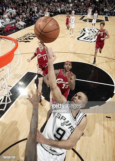 Tony Parker of the San Antonio Spurs shoots a layup past LeBron James of the Cleveland Cavaliers during a game at the AT&T Center January 17, 2008 in...