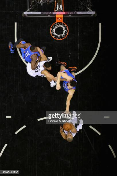Tony Parker of the San Antonio Spurs shoots against Steven Adams of the Oklahoma City Thunder in the second half during Game Five of the Western...