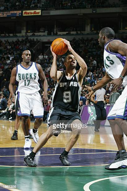 Tony Parker of the San Antonio Spurs shoots against the Milwaukee Bucks during the game at Bradley Center on March 11 2003 in Milwaukee Wisconsin The...