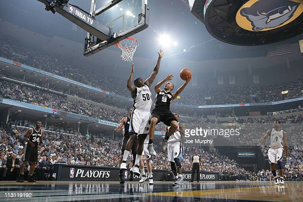 Tony Parker of the San Antonio Spurs shoots against Zach Randolph of the Memphis Grizzlies in Game Three of the Western Conference Quarterfinals in...