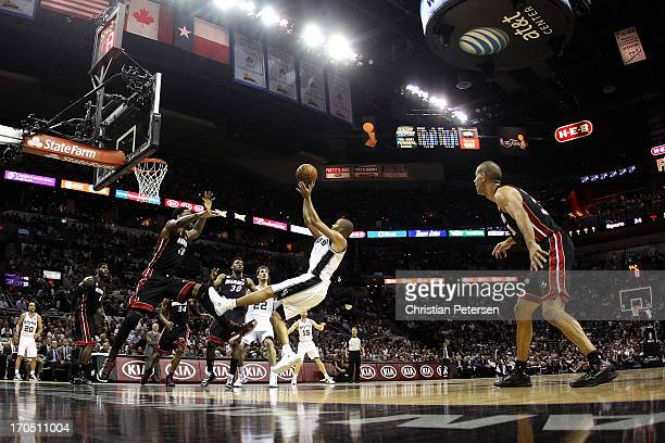 Tony Parker of the San Antonio Spurs shoots over Udonis Haslem of the Miami Heat in the first half during Game Four of the 2013 NBA Finals at the ATT...