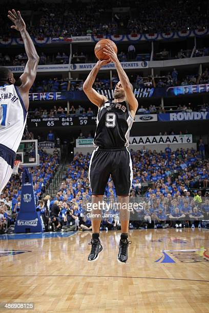 Tony Parker of the San Antonio Spurs shoots the ball against the Dallas Mavericks during Game Three of the Western Conference Quarterfinals during...