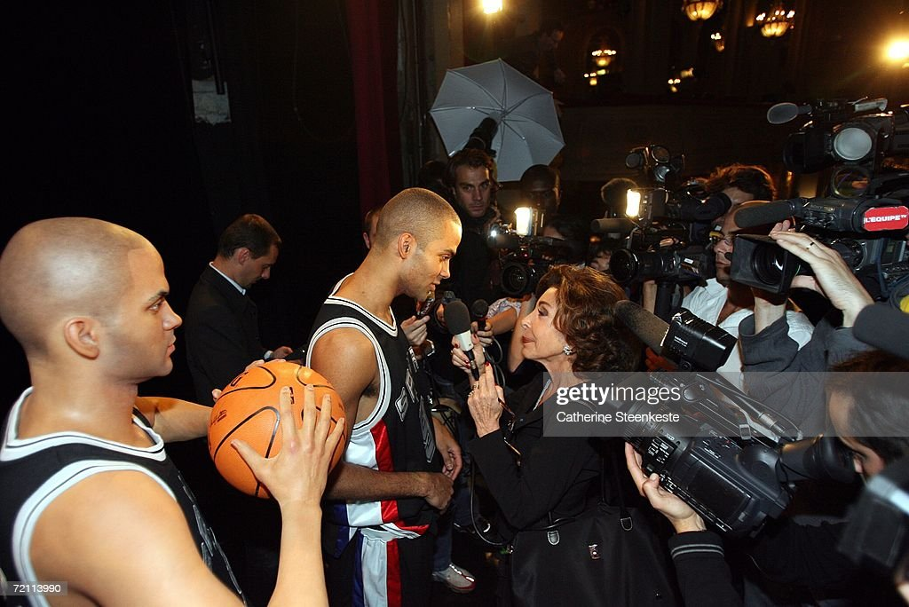 Tony Parker #9 of the San Antonio Spurs speaks to media while standing next to a wax figure made in his likeness at the Grevin Wax Museum during the NBA Europe Live presented by EA Sports on October 7, 2006 in Paris, France.