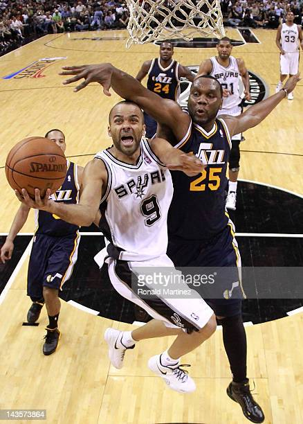 Tony Parker of the San Antonio Spurs takes a shot against Al Jefferson of the Utah Jazz in Game One of the Western Conference Quarterfinals in the...