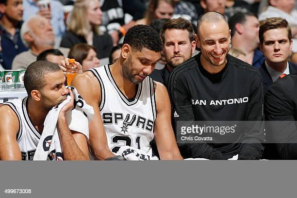 Tony Parker of the San Antonio Spurs Tim Duncan of the San Antonio Spurs and Manu Ginobili of the San Antonio Spurs talk on the bench during the game...
